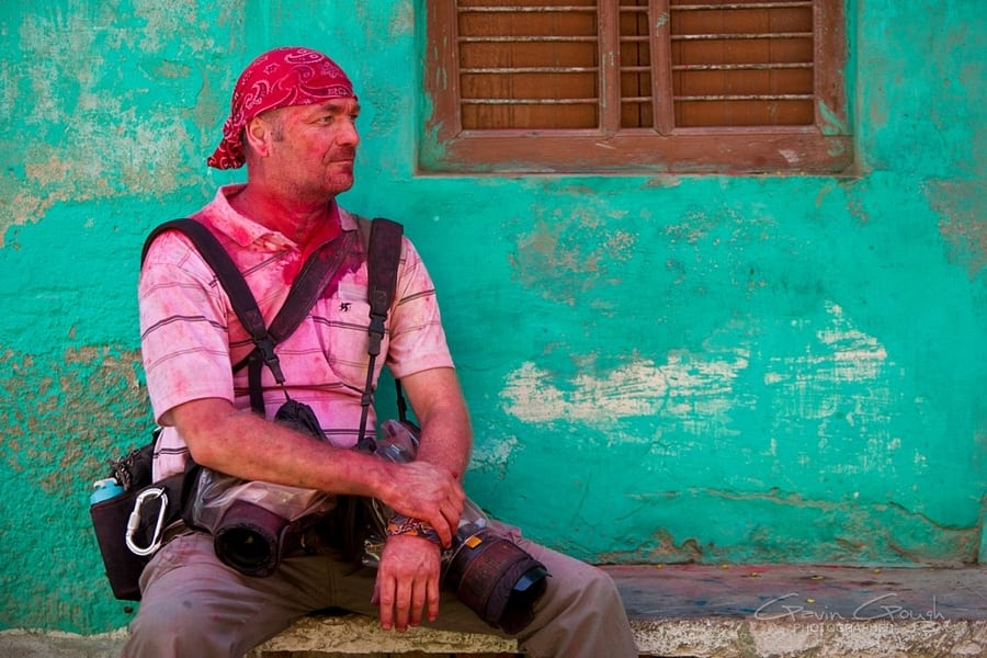 Western photographer Gavin Gough covered in coloured powder during Holi Festival Celebrations, India  Copyright Copyright © Lesley Fisher. All Rights Reserved.