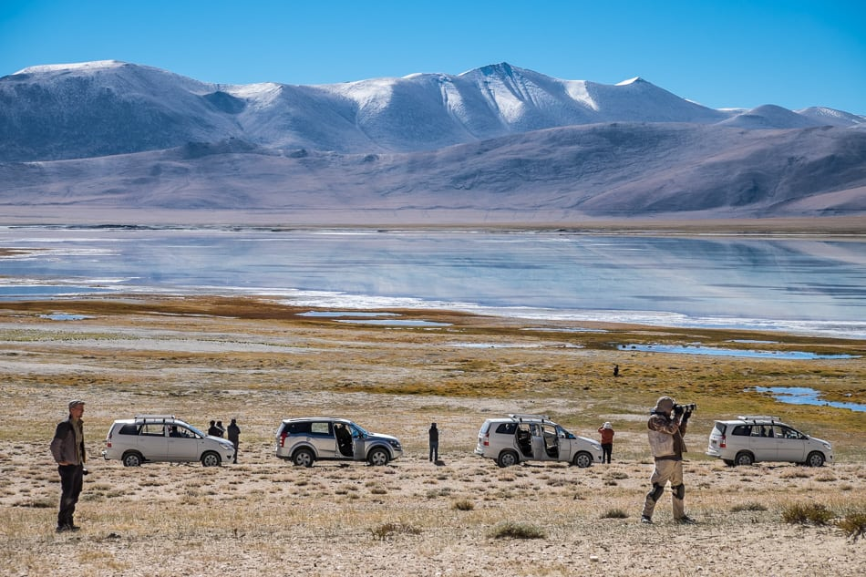 Participants stop on a drive around Tsorak Lake, Ladakh to photograph the mountain light.