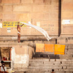 A sadhu washes his clothes on the bank of the Ganges.