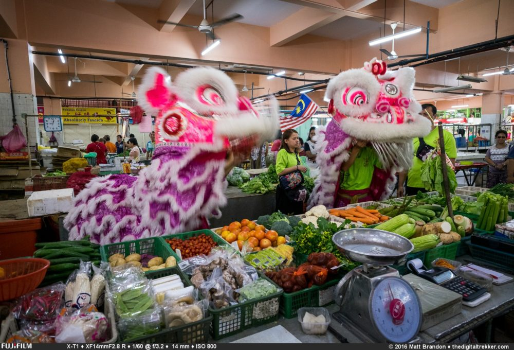 One of the fun events of Chinese New Year are the Lion Dances that happen all over the city. A troop of dancers and musicians dance to give a prosperity blessing to a shopkeeper in return for Aung Pow or a offering or gift.