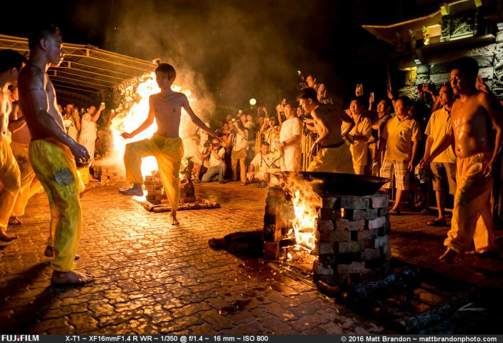 Possessed by spirits of children, the mediums dance around the fire playfully.