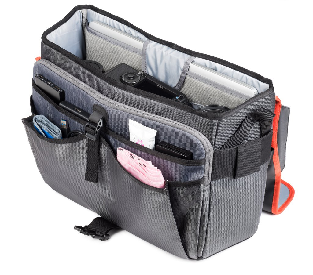 Internal pockets hold batteries, card wallets, and other accessories
