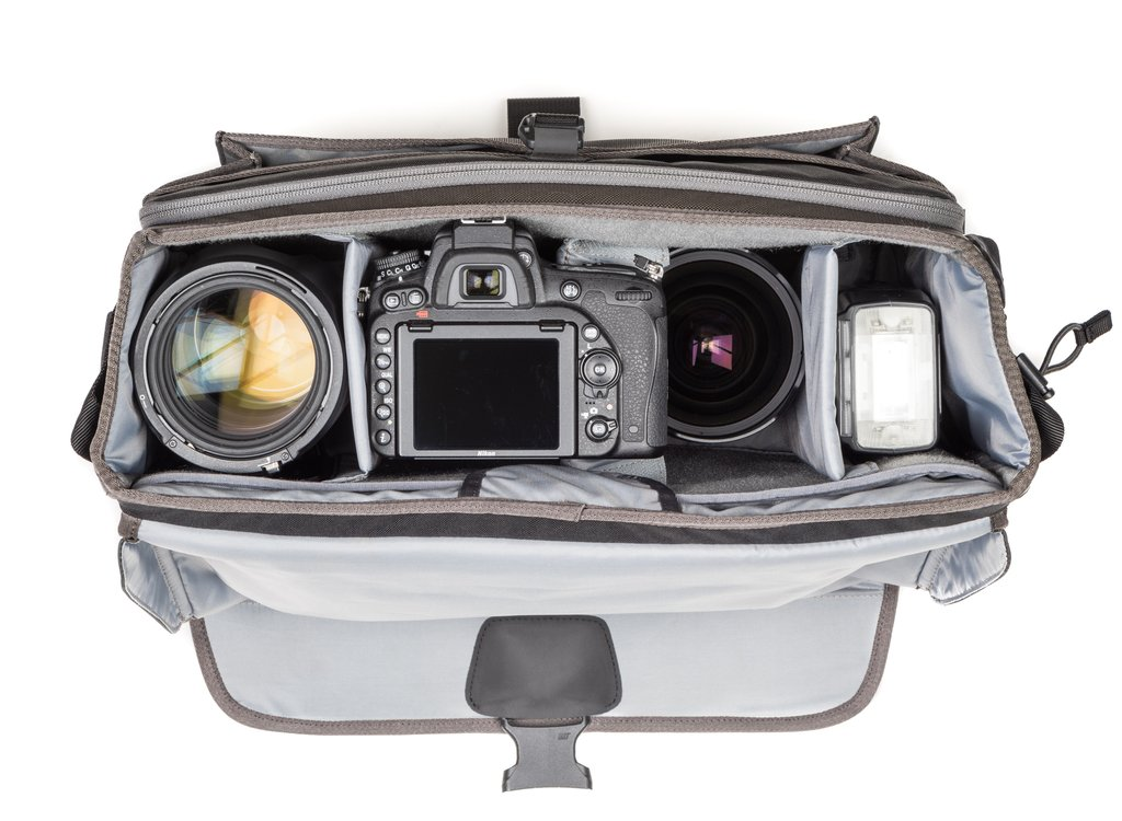 """Exposure 15: Fits one ungripped body with a 70–200mm f/2.8 attached, 2–5 extra lenses, flash, a 10"""" tablet and a 15"""" laptop."""