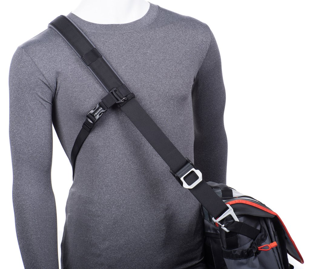 Cross-body stabilizer strap attaches to shoulder strap for active adventures